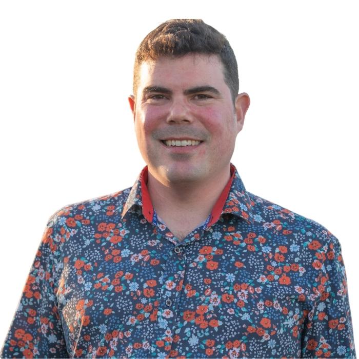 Mark Rinz, man smiling wearing colored shirt